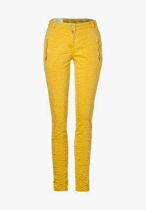 MIT CRASH - Trousers - gelb