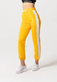 carpatree - RELAXED SWEATPANTS - Pantaloni sportivi - yellow - 3