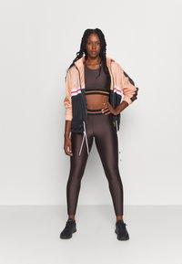 Casall - DEEP SPORTS - Medium support sports bra - powerful brown metallic - 1