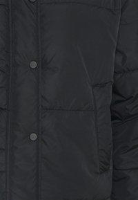 NU-IN - SHORT PUFFER JACKET - Light jacket - black - 2