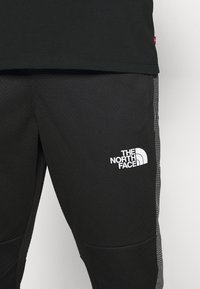 The North Face - CUFFED PANT - Träningsbyxor - black - 3