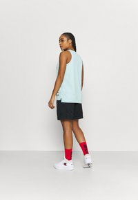Nike Performance - FLY ESSENTIAL SHORT - Sports shorts - black - 2