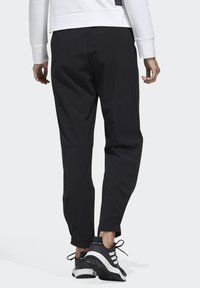 adidas Performance - STRETCHABLE WOVEN JOGGERS - Tracksuit bottoms - black - 1