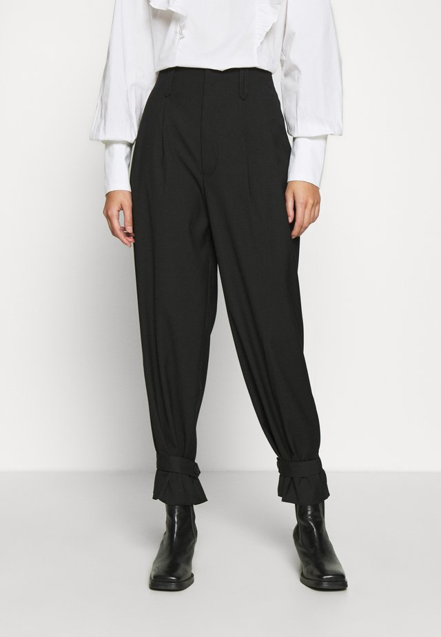 AIDA - Trousers - black