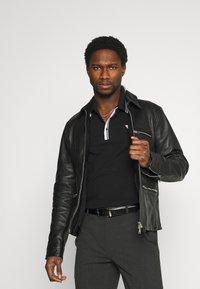 Guess - SCOTT - Polo shirt - jet black - 3