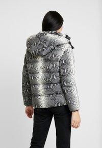 Urban Classics - LADIES HOODED PUFFER JACKET - Winter jacket - grey - 2
