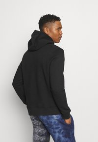 Nike Sportswear - COURT HOODIE - Mikina - black - 2