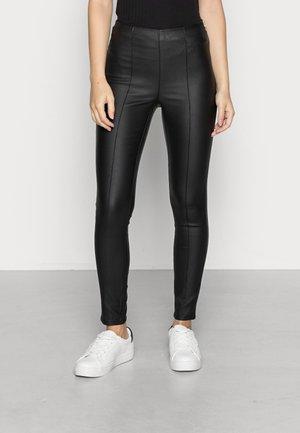 ONLCASSIDY ROCK ANK LEG - Trousers - black