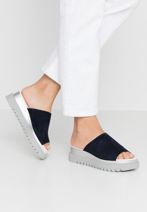Heeled mules - river