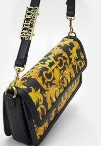 Versace Jeans Couture - LULA BAGUETTE - Handbag - black/dark yellow - 3