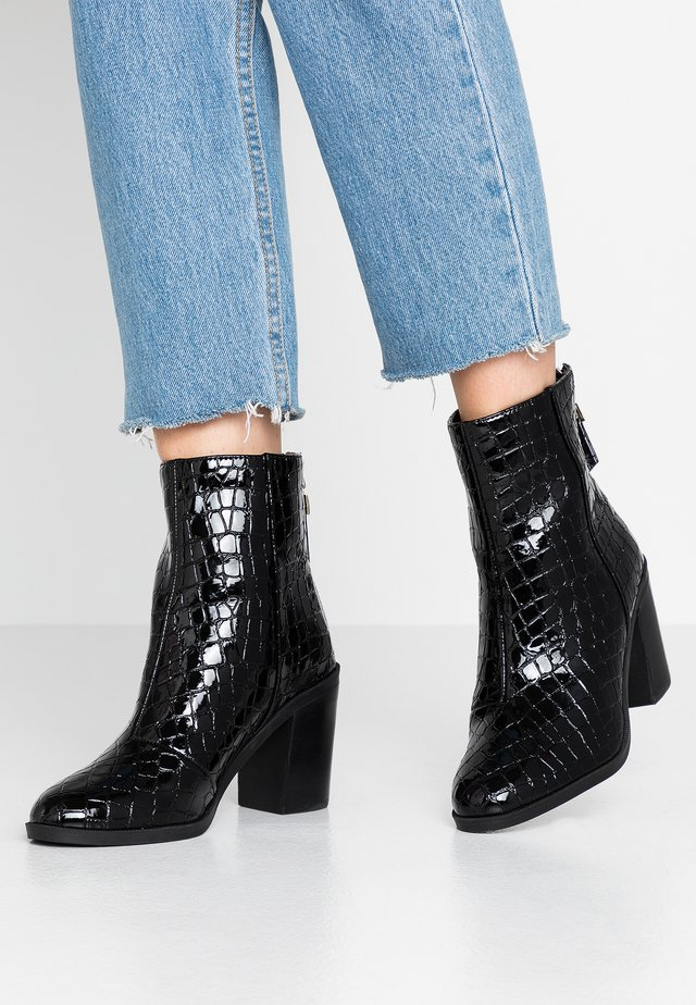 ARDEN - Classic ankle boots - black