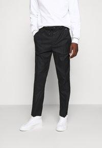 Calvin Klein - TAPERED ELASTIC DRAWSTRING PANT - Trousers - black - 0