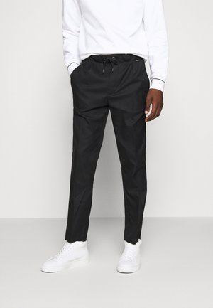 TAPERED ELASTIC DRAWSTRING PANT - Trousers - black