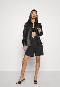 ONLY - ONLALISON JACKET - Faux leather jacket - black - 1