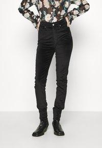 Levi's® - 721 HIGH RISE SKINNY - Jeansy Skinny Fit - caviar - 0