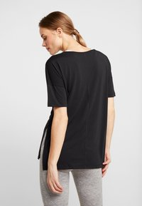 Nike Performance - YOGA LAYER - T-shirts - black - 2