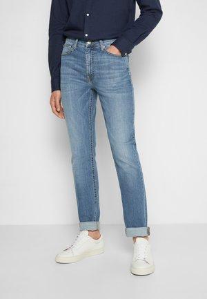 REED  - Slim fit jeans - medium light blue wash