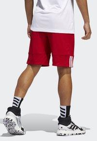 adidas Performance - SPEED REVERSIBLE SHORTS - Urheilushortsit - red - 1