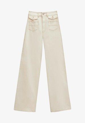 MIT TASCHEN - Straight leg jeans - beige