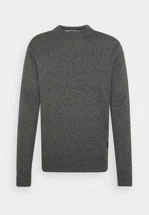Stickad tröja - granite melange