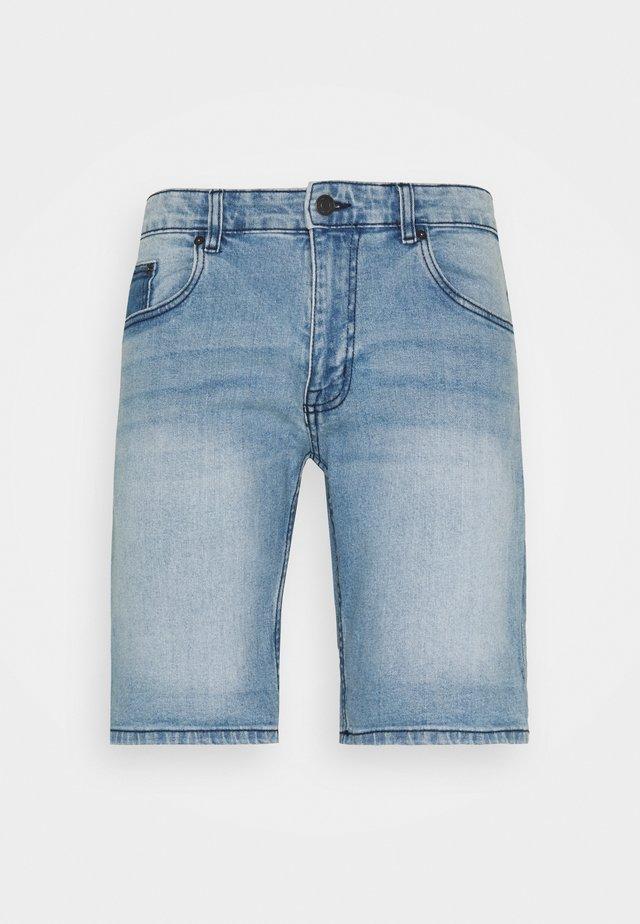 PARIS - Shorts di jeans - light blue