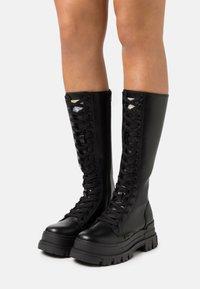 Buffalo - VEGAN ASPHA ON - Platform boots - black - 0