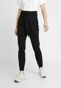 ONLY - ONLPOPTRASH EASY PAPERBAG PANT - Trousers - black - 0