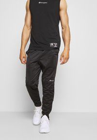 Champion - LEGACY CUFF PANTS - Pantalon de survêtement - black - 0