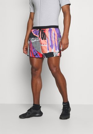 STRIDE SHORT - Sports shorts - bright mango