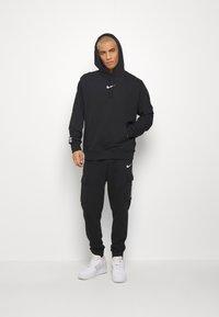 Nike Sportswear - PANT - Pantalones deportivos - black - 1
