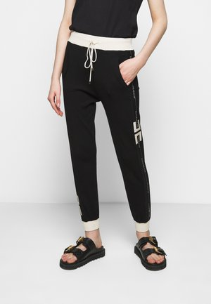 Tracksuit bottoms - nero/burro