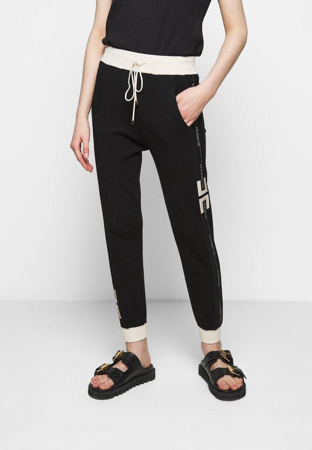 Pantaloni sportivi - nero/burro