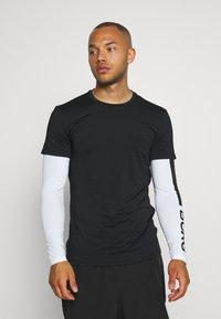 Björn Borg - ABER TEE - Sports shirt - black beauty - 2