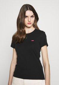 Levi's® - BABY TEE - T-shirts print - mineral black - 0