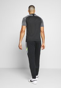 Nike Performance - DRY ACADEMY PANT  - Pantalon de survêtement - black/dark smoke grey/volt/light smoke grey - 2