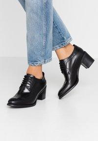 UMA PARKER - Ankle boots - nero - 0