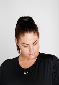 Nike Performance - ALL OVER PLUS - Basic T-shirt - black/white - 3