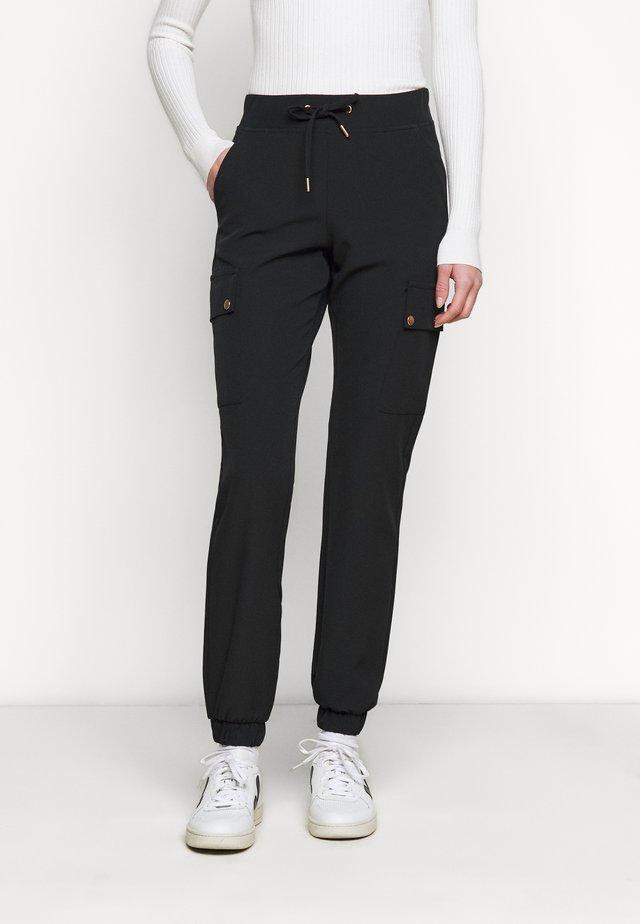 ONLGLOWING - Trousers - black