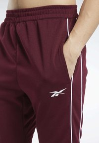 Reebok - WORKOUT READY JOGGERS - Tracksuit bottoms - burgundy - 4