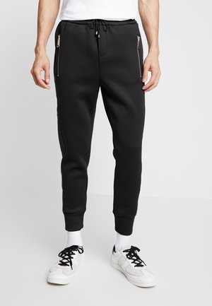 BEANDERAS - Tracksuit bottoms - black