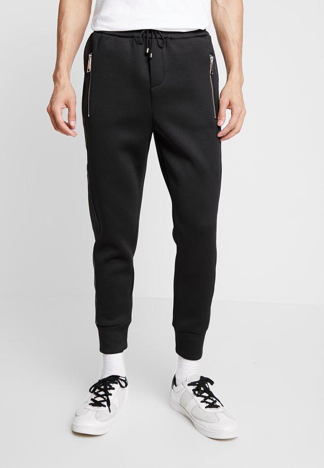 BEANDERAS - Spodnie treningowe - black