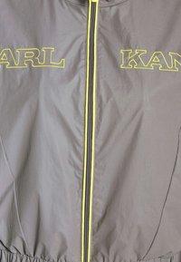 Karl Kani - RETRO SHINY SHORT TRACKJACKET - Summer jacket - grey - 6