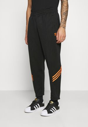 TRACK PANT UNISEX - Tracksuit bottoms - black/trace orange
