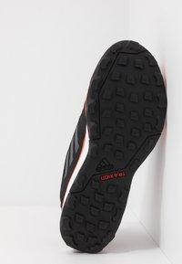 adidas Performance - TERREX AGRAVIC TR GTX - Obuwie do biegania Szlak - core black/grey four/solar red - 4
