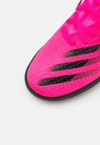 adidas Performance - X GHOSTED.3 TF UNISEX - Astro turf trainers - shock pink/core black/screaming orange - 5
