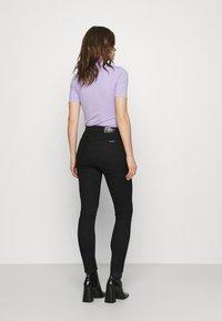 Calvin Klein Jeans - HIGH RISE ANKLE - Skinny džíny - denim black - 2