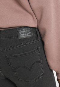 Levi's® - 710 SUPER SKINNY - Jeans Skinny Fit - black - 4