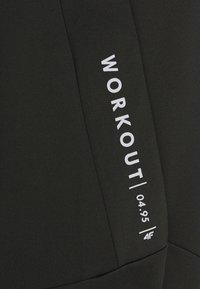 4F - Men's training pants - Tracksuit bottoms - black - 2