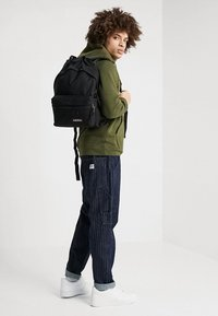 Eastpak - PADDED ZIPPLER - Rucksack - black - 1