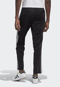 adidas Originals - ADICOLOR CLASSICS FIREBIRD PRIMEBLUE TRACK PANTS - Tracksuit bottoms - black - 1